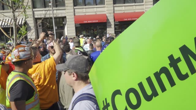 brief scuffle between workers. members of the laborers' nyc locals joined with other nyc building construction trades to hold the #countmein... - 50 seconds or greater stock-videos und b-roll-filmmaterial