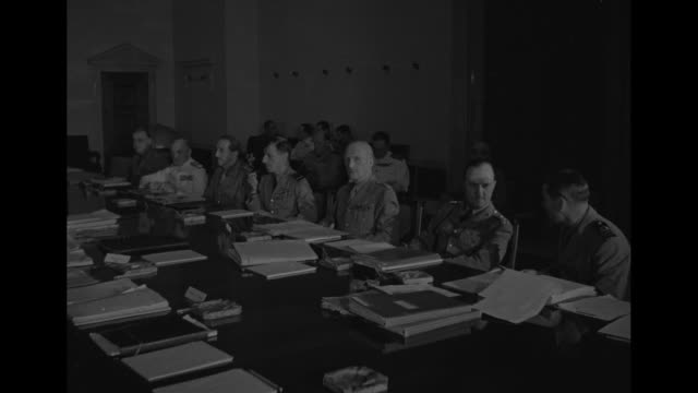 cu briefing book lying on table next to name card with name sir john dill on it / leaders sitting along both sides of long table in conference room /... - field marshal stock videos and b-roll footage