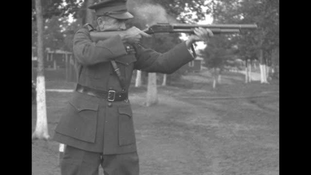 stockvideo's en b-roll-footage met wwi brigadier general logan feland fires a rifle / points gun at camera / logan without gun - jachtgeweer