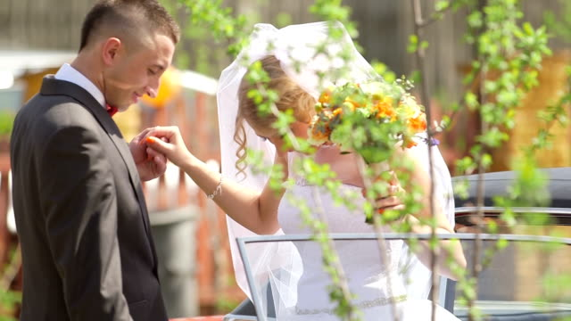 brige and groom leaving car - stock footage - 25 29 years stock videos & royalty-free footage