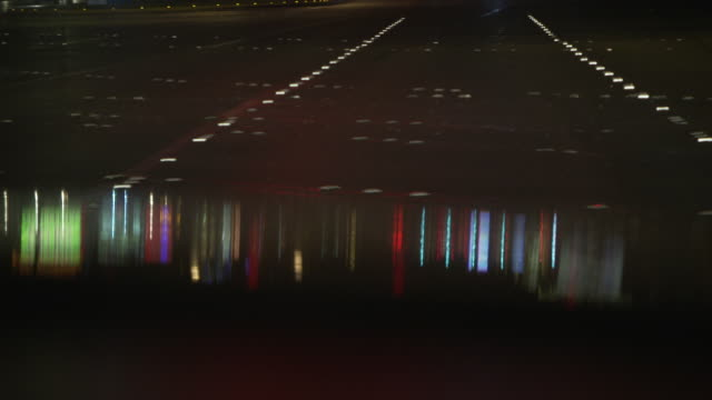 bright, coloured lights are reflected on the bonnet of a car as it waits at traffic lights in las vegas, nevada, usa. - casino stock videos & royalty-free footage