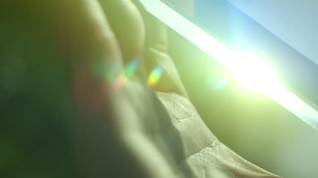 bright diffracted sunlight shines through a glass prism, creating lens flare. - lichtbrechung stock-videos und b-roll-filmmaterial