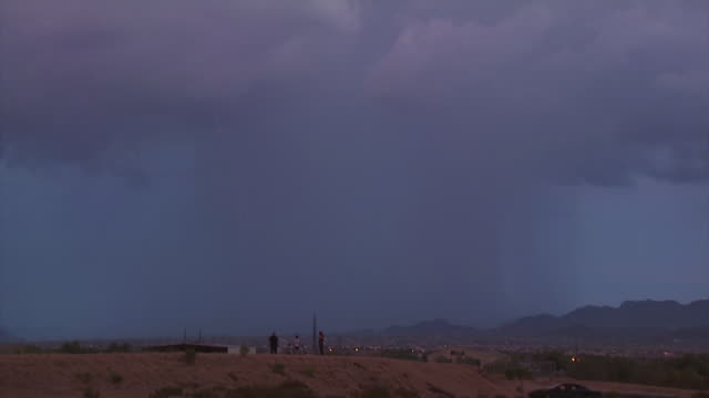 Bright double lightning bolt strikes hill near Tucson, Arizona, USA.