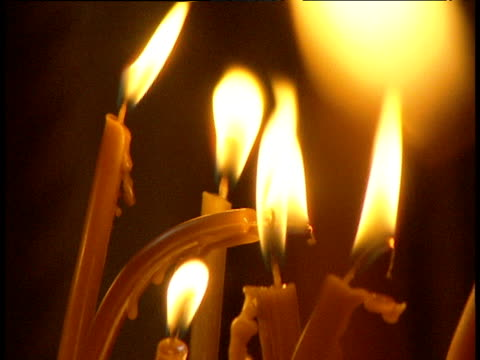 bright flames of candles - wax stock videos & royalty-free footage
