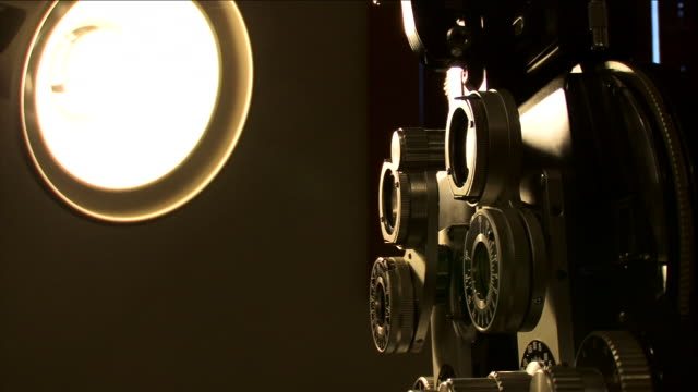 a bright light shines on optometry equipment. - lens optical instrument stock videos & royalty-free footage