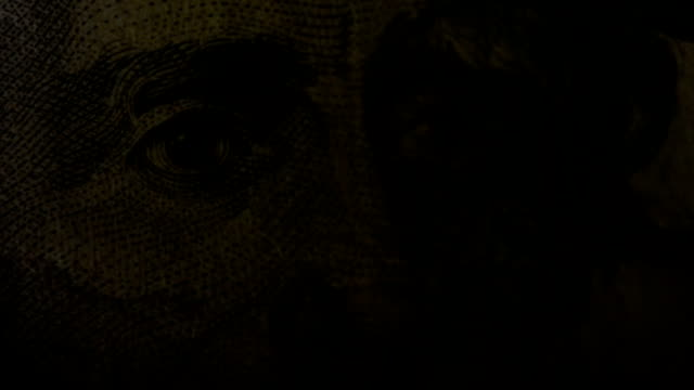 bright light shines onto and off of andrew jackson's face on the us $20 note - twenty us dollar note stock videos & royalty-free footage