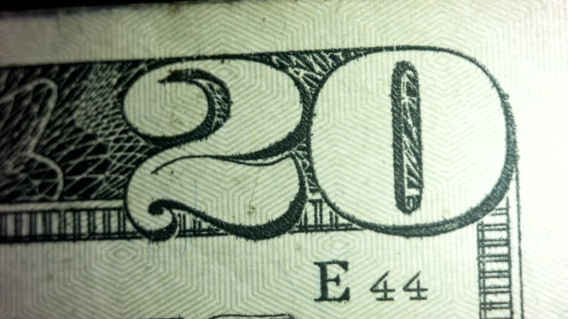 bright light shines onto and off of the twenty dollar bill - twenty us dollar note stock videos & royalty-free footage