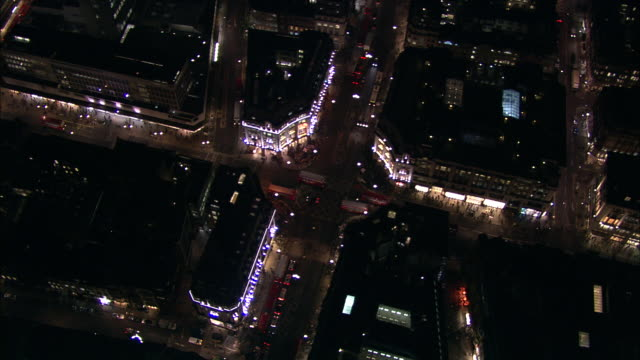 bright lights and traffic at oxford circus london available in hd. - oxford circus stock videos and b-roll footage
