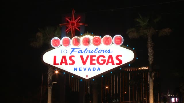 bright lights of las vegas nights/ old designs offer glimpse of past glamour/ iconic welcome to las vegas sign greets visitors - casino lights stock videos & royalty-free footage