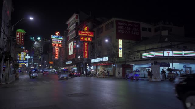 bright neon shop and hotel lights by busy main road of chinatown in bangkok, thailand, southeast asia, asia - southeast asia stock videos & royalty-free footage