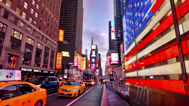 bright shining american flag. yellow taxis. times square. new york - taxi stock videos & royalty-free footage