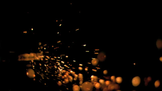 Bright sparks flowing in super slow motion