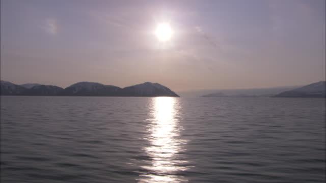 a bright sun shines above prince william sound, alaska. - prince william stock videos & royalty-free footage