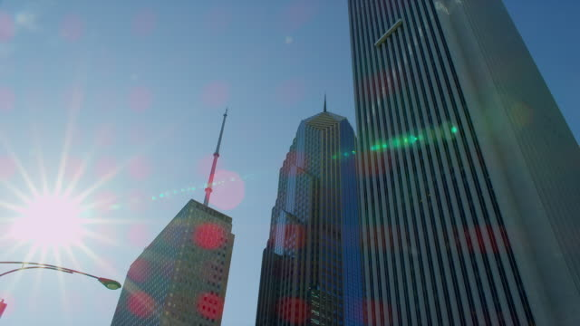 a bright sun shines over one prudential plaza, two prudential plaza, and the aon center in chicago, illinois. - one prudential plaza stock videos & royalty-free footage