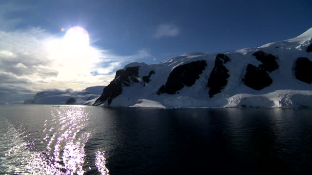 bright sun shining in antarctic peninsula - polar stock videos & royalty-free footage