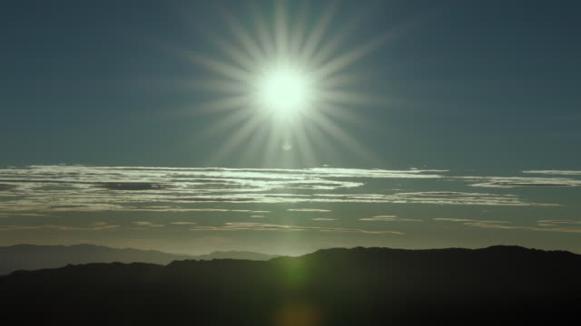 bright sun shining over mountains, in silhouette. - basin and range province stock videos and b-roll footage