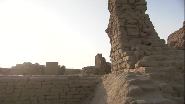 Bright sunlight shines above the ruins of the ancient city of Gaochang Silk Road China