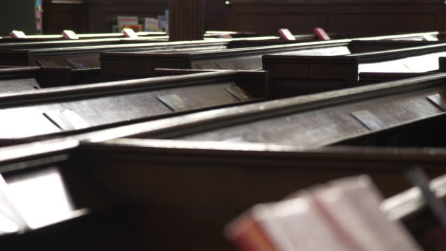 bright sunlight shines on church pews - bible stock videos & royalty-free footage