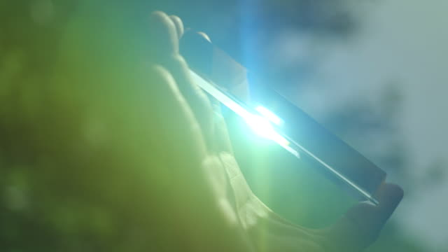 bright sunlight shines through a glass prism, separating into the different colours of the spectrum. - lichtbrechung stock-videos und b-roll-filmmaterial