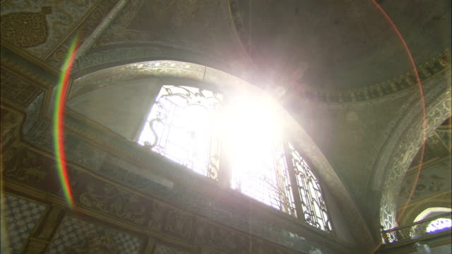 bright sunlight shines through arched windows in the ceiling of the queen mother's private apartments at the topkapi palace. available in hd. - topkapi palace stock videos and b-roll footage