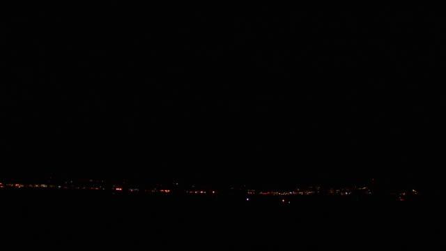Bright zig-zag lightning arcs across night sky followed by second bolt of forked lightning during thunderstorm, Arizona Monsoon, USA
