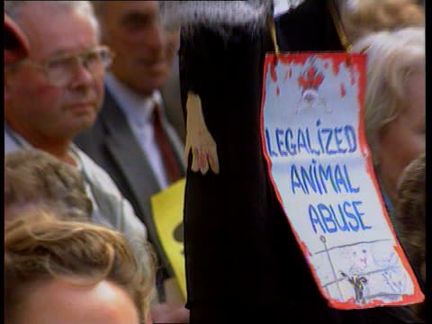 Brightlingsea ENGLAND London Strand CS Banner held by animal rights protester outside court hung on effigy of judge PULL OUT MS Animal rights demo