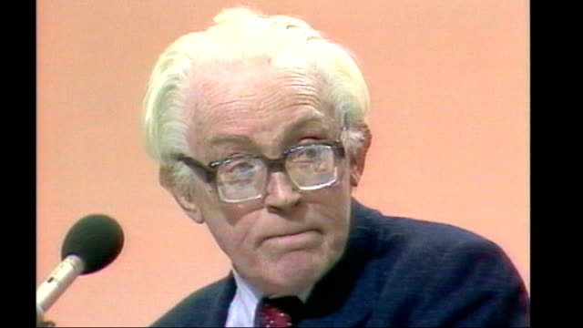 brighton: int sequence michael foot and wife, jill craigie, standing at labour conference as applauded by delegates, then they sing 'for he's a jolly... - gerald kaufman stock videos & royalty-free footage