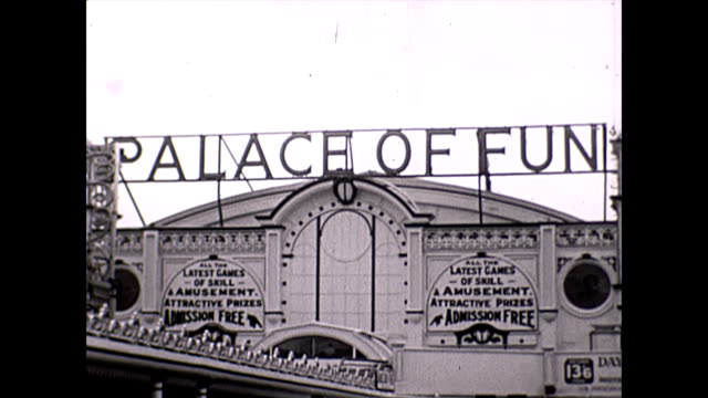 brighton palace pier montage exterior shot of the entrance to the palace of fun at brighton / interior shot of crowds / exterior shot of visitors... - brighton brighton and hove stock-videos und b-roll-filmmaterial