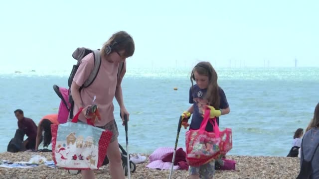 brighton residents and eco-enthusiasts join a silent disco beach cleanup event organised by local organisation pier 2 pier which aims to bring an... - cleaning stock videos & royalty-free footage