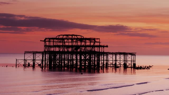brighton west pier with colourful sunset - drone shot - 1975 stock videos & royalty-free footage