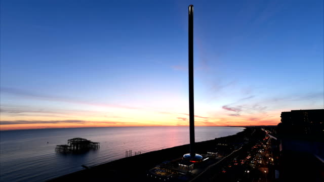 brighton's british airways i360 observation tower is seen in a timelapse filmed from the hilton metropole - brighton brighton and hove stock-videos und b-roll-filmmaterial