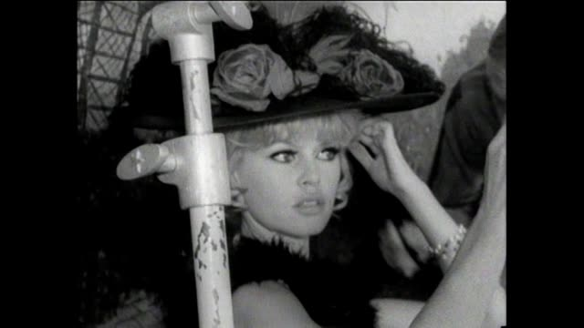 Brigitte Bardot backstage preparing for her role in Viva Maria / Checking costume hair and makeup