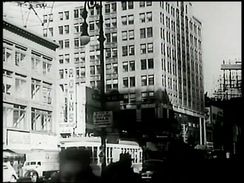 brill building people walking on sidewalk fg. - 1943 stock-videos und b-roll-filmmaterial