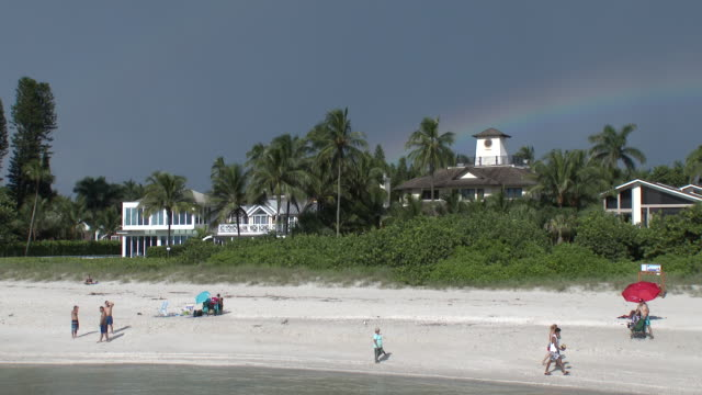 brilliant rainbow over naples beach, florida - naples florida stock videos & royalty-free footage