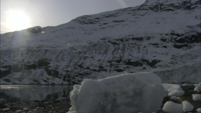 a brilliant sun shines above glaciers in prince william sound, alaska. - prince william stock videos & royalty-free footage
