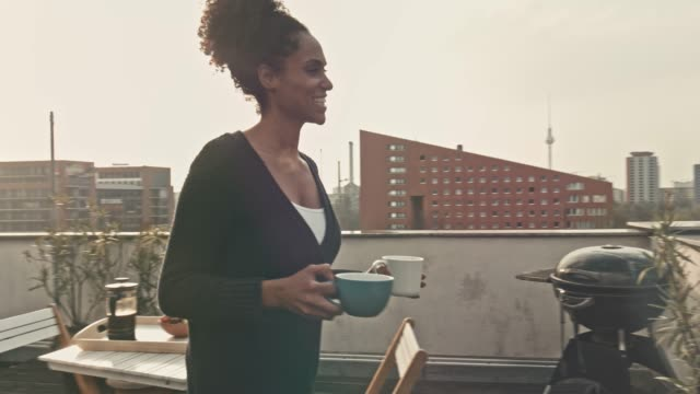 bringing coffee to her partner at terrace - washing line stock videos & royalty-free footage