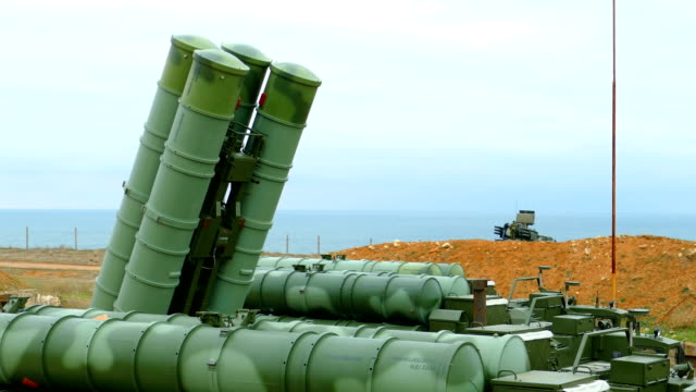 bringing in combat position -anti-aircraft missile system of large and medium range on the coast - missile stock videos & royalty-free footage