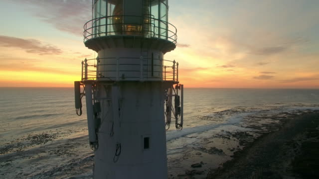 bringing light to the ocean at night - lighthouse stock videos & royalty-free footage