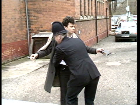 court case b england dartford court ms police guarding entrance to court / bv policeman searching man / ts police armed escort arriving / ms kenneth... - mat stock videos and b-roll footage