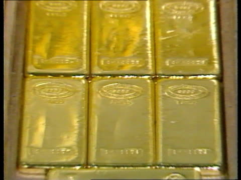 brinks mat loot investigation brinks mat loot investigation itn lib johnson mathey bank tcs tray of gold ingots pull out tcms trays of ingots nao - mat stock videos and b-roll footage
