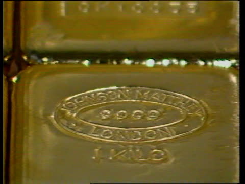 brinks mat trial; itn lib int molten gold poured into ingot cast cms gold ingot pull out more itn lib england: bristol: barclays bank ext barclays... - cashier stock videos & royalty-free footage