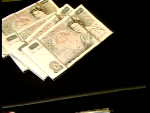 brinks mat trial itn tcms wads of â£10 notes dropped on top of each other - mat stock videos and b-roll footage