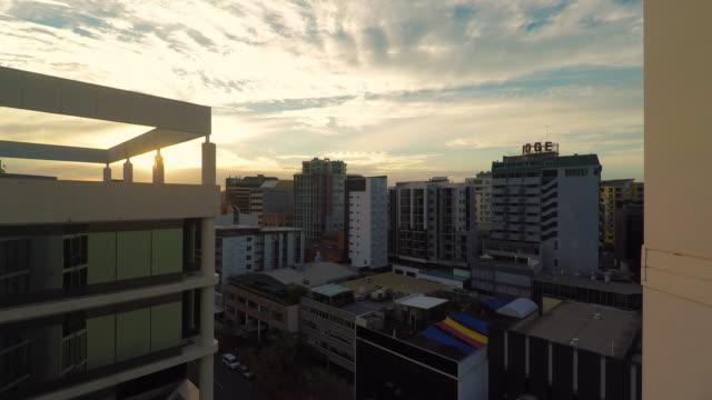 brisbane australia skyline at sunset - flat stock videos & royalty-free footage