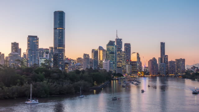 brisbane city skyline and brisbane river at sunset in australia - downtown stock videos & royalty-free footage