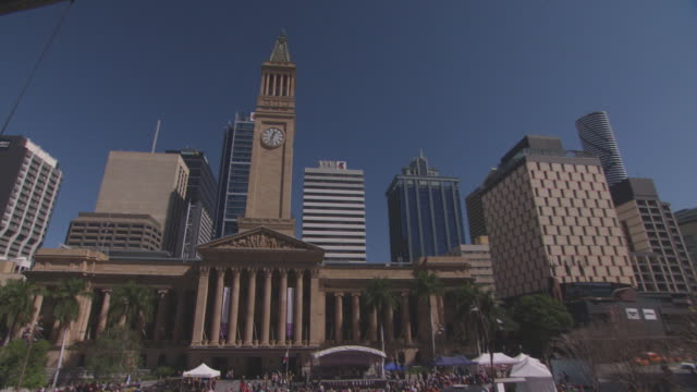 brisbane city town hall clock tower surrounded by modern glass buildings a mirror ball sculpture sits in the foreground / close up of clock tower and... - blue glass stock videos and b-roll footage