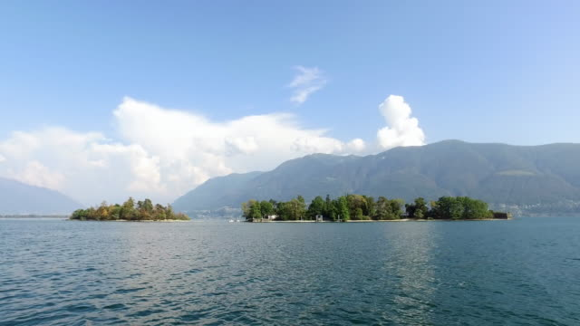 stockvideo's en b-roll-footage met brissago islands on a lake. - 40 seconds or greater