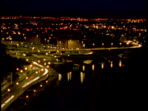 t/l bristol city at night - roads in foreground with river avon, lit city in background, blue sky darkens to black sky - bristol england stock videos and b-roll footage