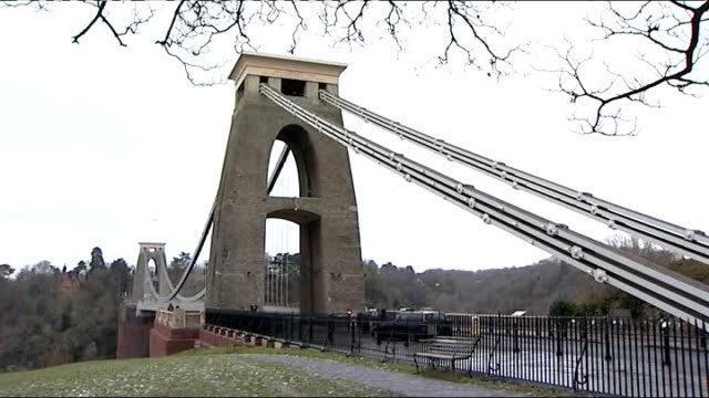 police officers outside block of flates where joanna yeates lived clifton suspension bridge somerset: failand: police officer and police cars... - searching点の映像素材/bロール