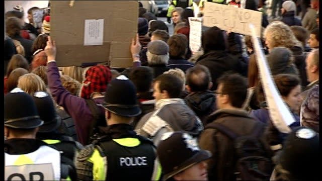 Bristol EXT Mounted riot police leading demonstration by students over government plans to triple university tuition fees Massed crowd of student...