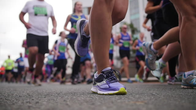runners feet slow motion - charity benefit stock videos & royalty-free footage